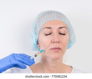 portrait of a girl in the medical cap for cosmetic injections