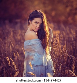 Portrait of a girl on an autumn background