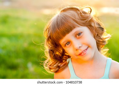 Portrait of a girl on a background of green grass