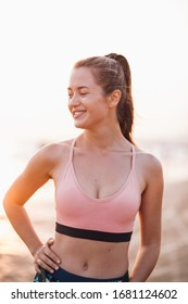 portrait of a girl on the beach during sunset after jogging