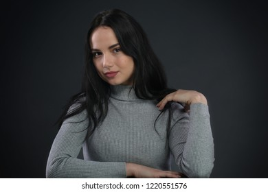 Portrait of girl on dark gray background