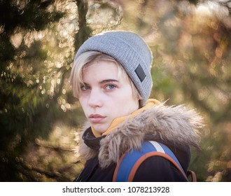 Portrait of a girl on an evening walk in the Park