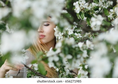 Portrait of girl on of flowers background.