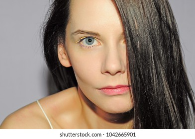 Portrait of a girl on a gray background