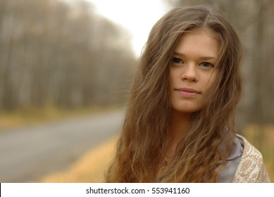 Portrait of a girl on a road