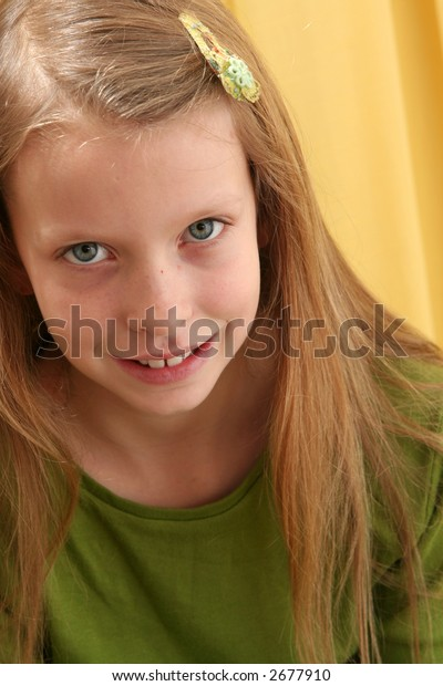 Portrait of a girl on a yellow background