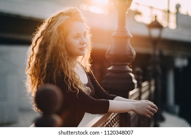 Portrait of a girl outdoors. the girl at sunset. portrait, bridge, embankment, girl.