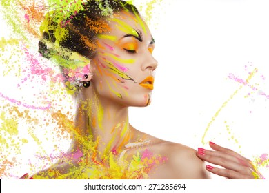 portrait of a girl in the paint. portrait of a girl in the paint. young girl on a light background in spray paint