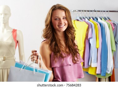 Portrait of a girl with paper bags in clothing department