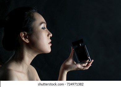 Portrait girl with perfume bottle, back light
