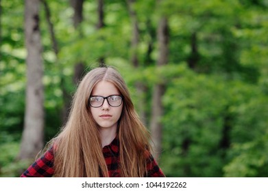 Portrait of a girl in a plaid shirt