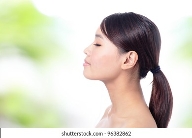 Portrait of girl in profile and close her eye with green background, model is a asian beauty