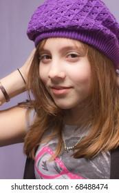 Portrait of a girl in a purple hat
