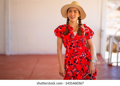 portrait girl in red a dress and hat