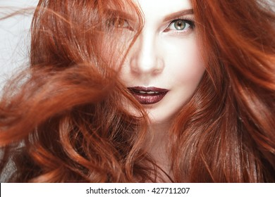 Redhead with brown eyes makeup are
