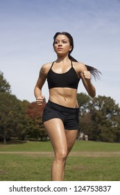Portrait of a girl running in the park   background