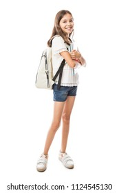 Portrait of girl with school backpack holding books isolated on white background