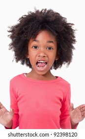 Portrait of a girl screaming against a white background