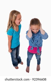 Portrait of a girl screaming at her friend against a white background