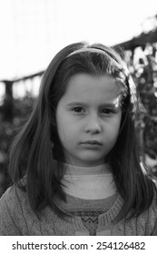 portrait of girl of seven very serious