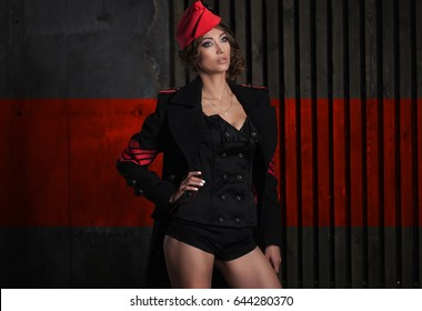portrait of girl in a sexy black aviator uniform with hat