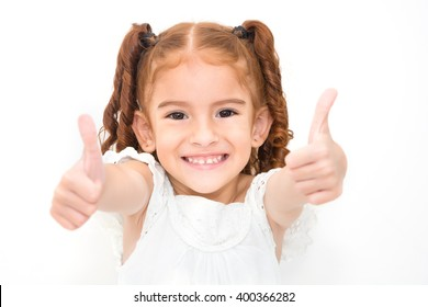 Portrait of a girl showing thumbs up isolated one white
