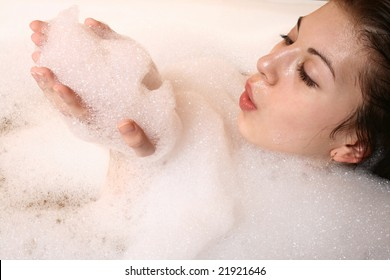 Portrait of the girl sitting in a bath.