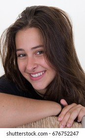 A portrait of a Girl smiling with a broad smile, shot on a white background