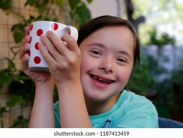 Portrait of the girl smiling with white  cup