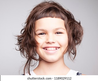 Portrait of a girl with a stylish hairstyle with a short bangs and nice smile