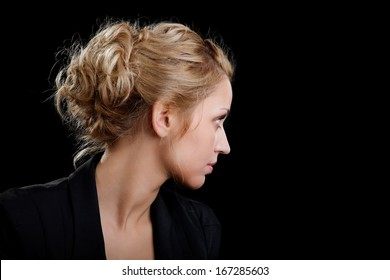 Portrait of the girl in a suit looking aside