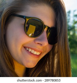 Portrait of a Girl in Sunglasses on a Summer Day. Girl portrait. Beauty Portrait of Summer Girl. Closeup Beautiful Girl.