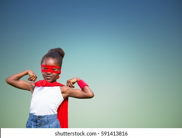 Portrait of girl in superhero costume flexing her arms against green background