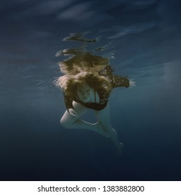 Portrait of a girl swimming underwater