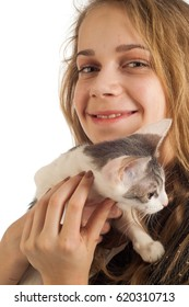 Portrait of a girl. Girl teenager 13 years old. Girl 13 years old in a black jacket, in the hands of a girl kitten