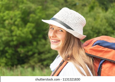 Portrait of girl tourist with a backpack