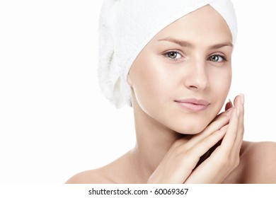 Portrait of a girl in a towel on a white background