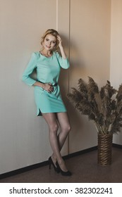 Portrait of a girl in a turquoise dress.