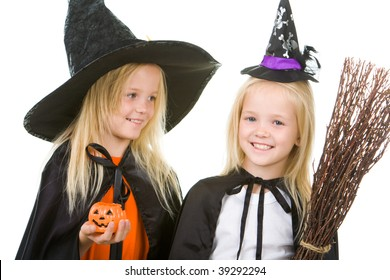Portrait of girl twins in black hats and black clothing