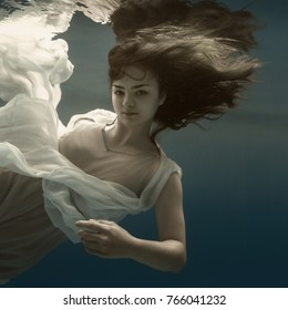 Portrait of a girl under the water