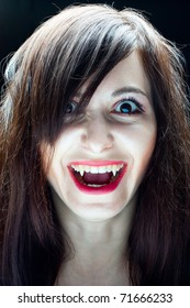 Portrait of a girl vampire on a black background