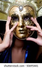 Portrait of girl in a Venetian mask