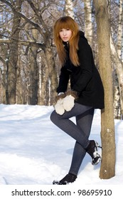 Portrait of a girl walking in park in winter