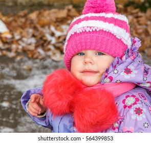 Portrait of a Girl in a warm jacket and hat, age 2 years