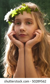 portrait of a girl wearing a crown of ivy
