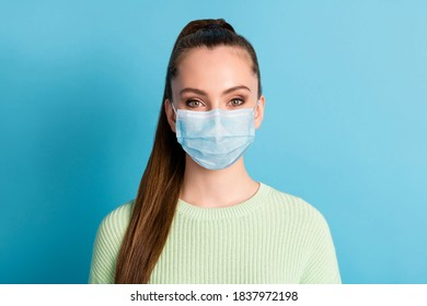 Portrait of girl wearing mask green pullover isolated over bright vivid shine vibrant blue color background - Shutterstock ID 1837972198