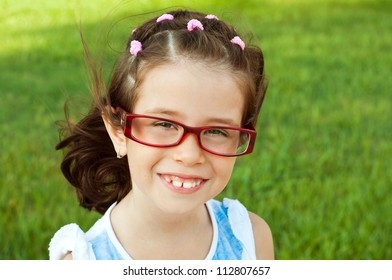 Portrait of a girl wearing red glasses