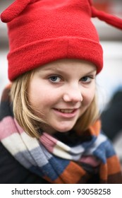 Portrait of girl wearing red knit hat