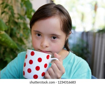 Portrait of the girl with white cup
