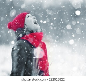 portrait of a girl who catches snowflakes mouth portrait snow christmas